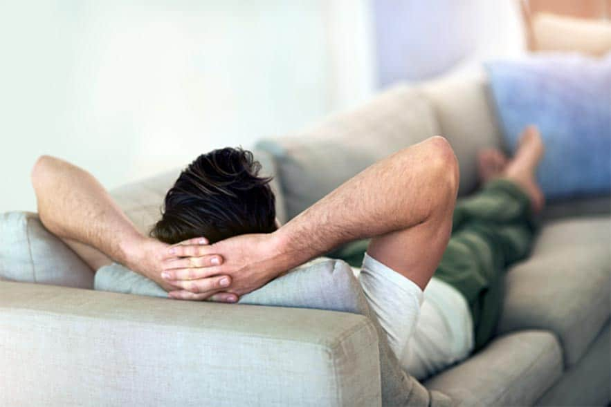 Vasectomy recovery, man resting at home